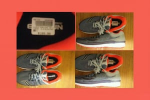 pair of gray-and-orange Nike basketball shoes
