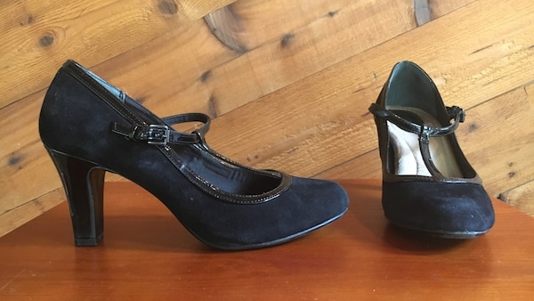 pair of black suede round-toe heeled shoes