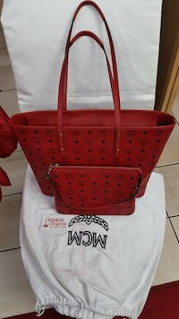 red monogrammed MCM leather tote bag and handbag