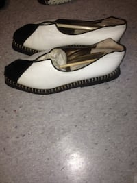 pair of white leather flats Surrey