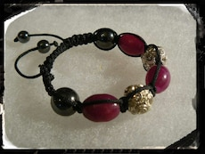 black,red and brass bracelet