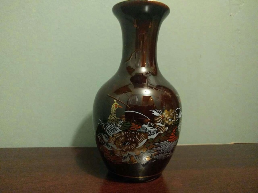 brown, white, and beige peacock print ceramic vase