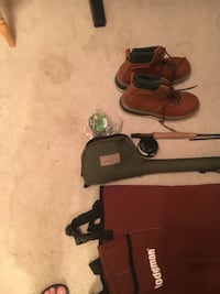 Fly fishing rod and wadders. Size 10 boot wadders are are large. Fly rod is from LL Bean