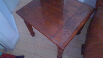 brown wooden table with glass
