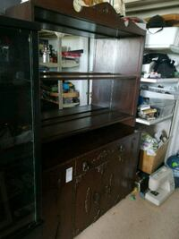 brown wooden TV hutch with flat screen television Welland, L3B 5N5