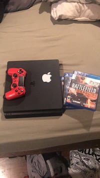 black Sony PS4 with red game pad and three game cases Jefferson, 30549