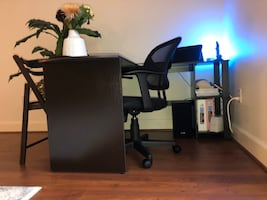 Desk with rolling office chair