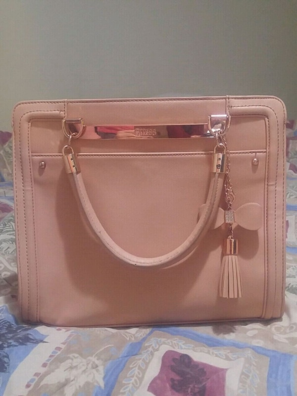 Used GUESS women s pink leather tote bag for sale in Aurora - letgo dc37ab1869318