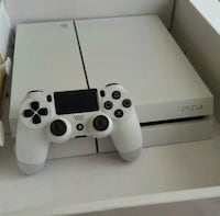white Sony PS4 console with controller Washington