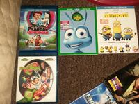 four Disney DVD movie cases