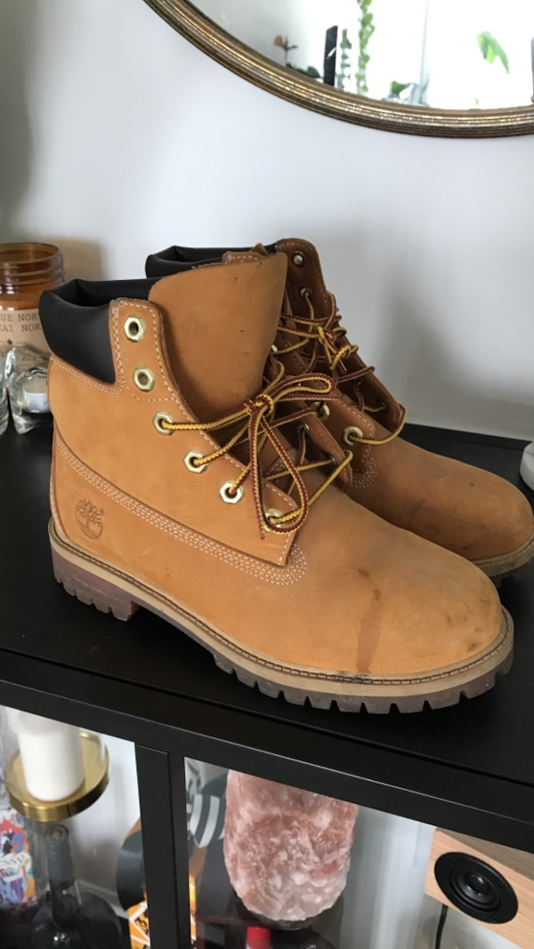 Brown-and-black Timberland work boots 9323c3e2-2695-41a8-bc45-b0e02291cd62