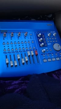 blue and gray Tascam audio mixer