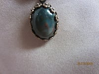 $16.00 Firm price) Sorry this is a bad picture, it is a gorgeous lite & dark blue lapis cab .handset in a bronze mount/W/ 18in necklace.-2018-0112