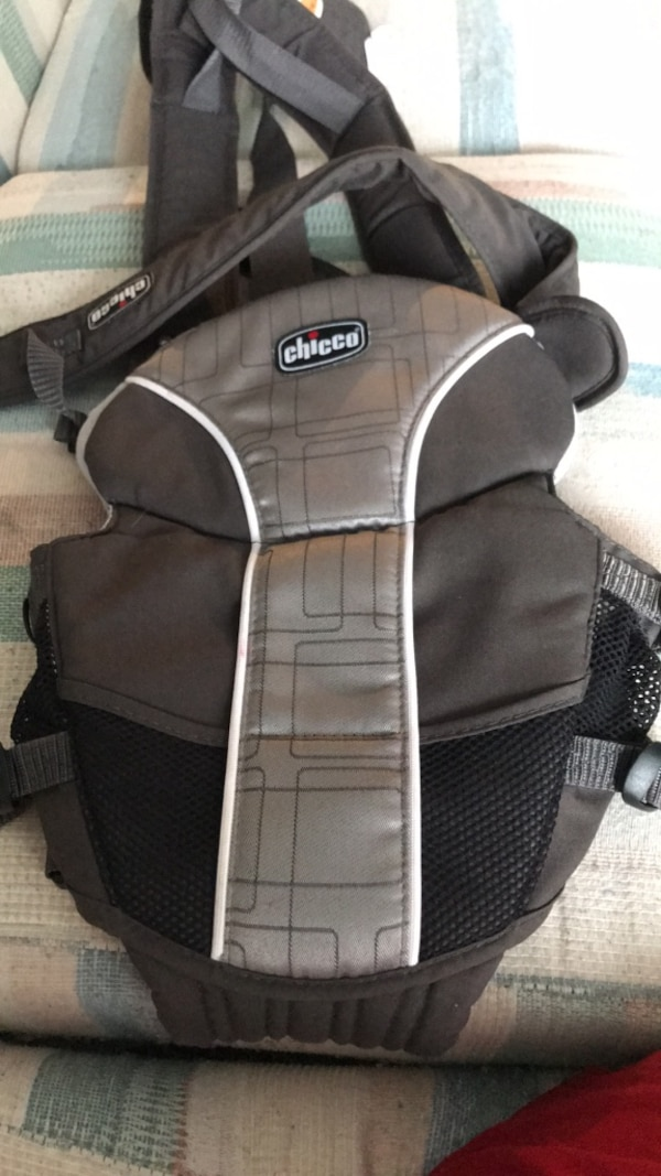 black and gray Chicco carrier