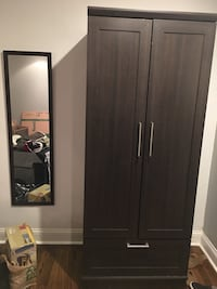 Wardrobe armoire, hanging rod and storage . Will come with matching mirror Sterling, 20165