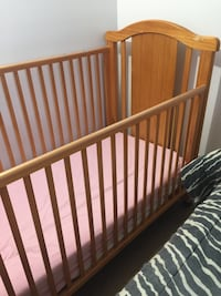baby's brown wooden crib Laval, H7W 2W3