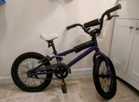 Childrens bicycle purple and black