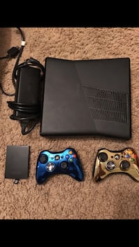 black XBOX 360 and blue and gold wireless controllers Washougal, 98671