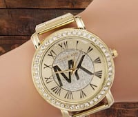 round silver-colored analog watch with link bracelet 702 mi