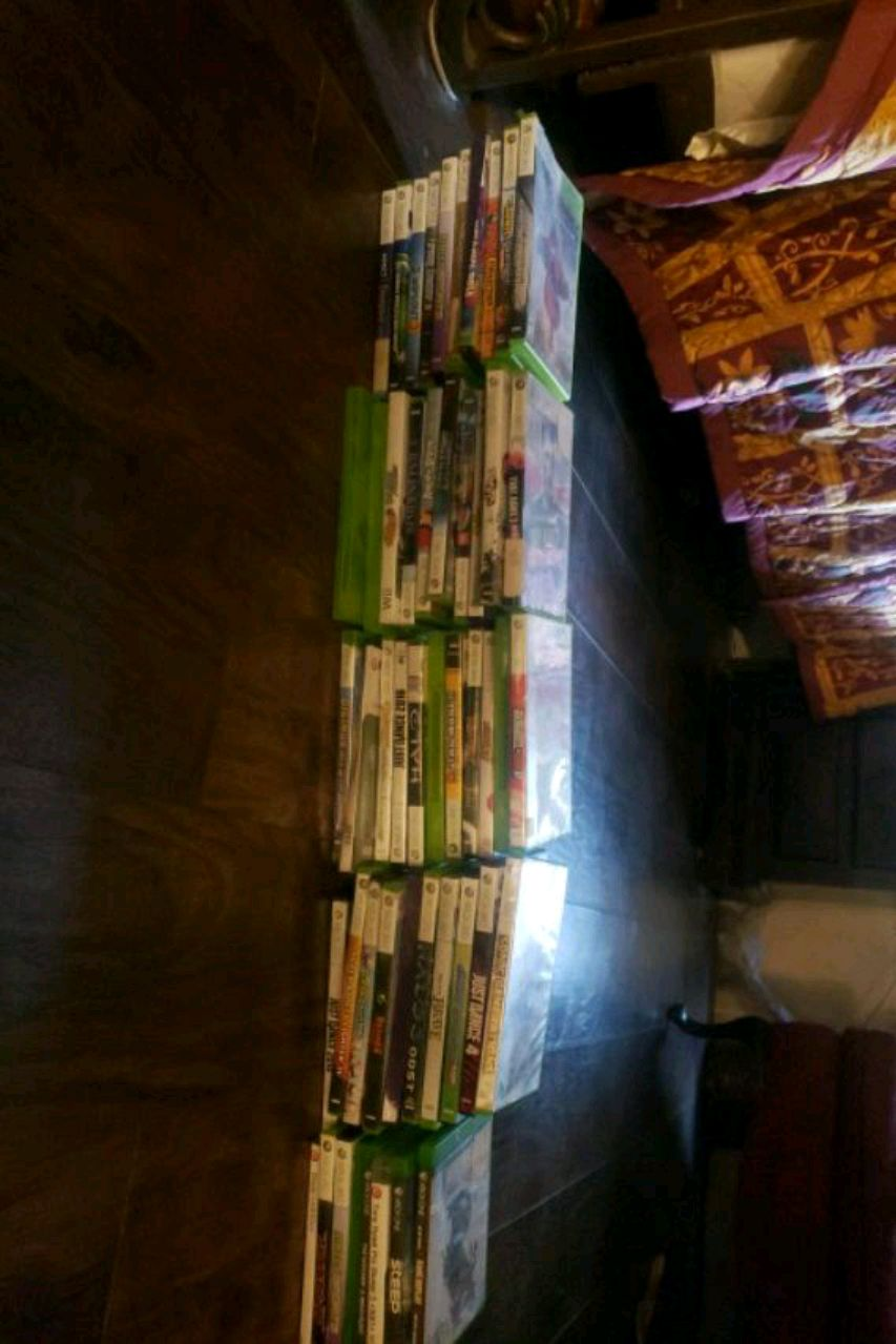 Photo 50 x box 360 games and 6 x box one games all for 100
