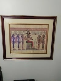 painting of Egyptian Pharaoh with brown wooden frame