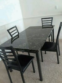 dining table and 4 chairs. Top is granite material Manassas, 20109