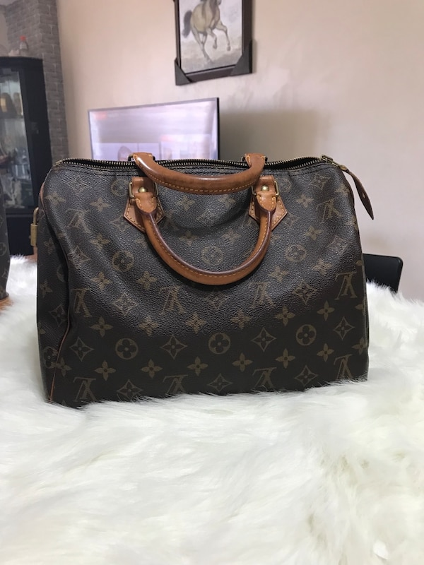 black and brown Louis Vuitton monogram leather handbag