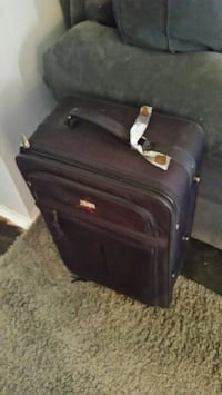 black and gray luggage bag Longueuil, J4K 2W6