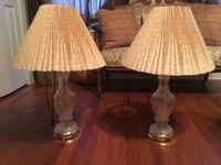 two crystal table lamp bases with beige shades