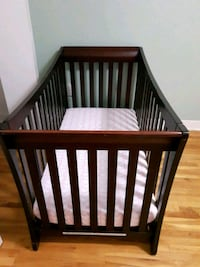 baby's brown wooden crib Laval, H7W 2J6