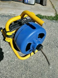blue and yellow canister vacuum cleaner