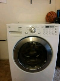 white LG front-load clothes washer 2229 mi