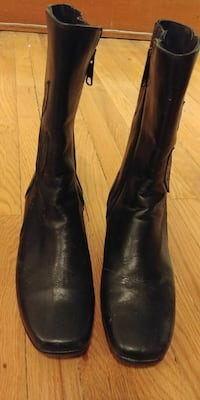pair of black leather bicycle-toe mid-calf boots