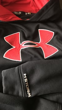 Black and red Underarmour hoodie excellent condition smoke free home youth medium Manchester, 03104