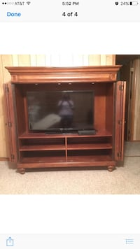black flat screen TV with brown wooden TV hutch Opelousas, 70570