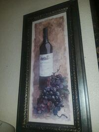 white labeled liquor bottle with grapes painting