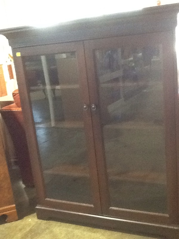 brown wooden framed glass cabinet