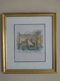 brown wooden framed painting of house near body of