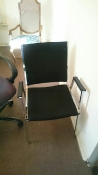 black and gray metal-framed armchair