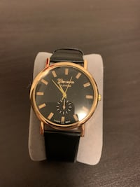 Black and Faux Gold Leather Watch Pickering, L1X 2V5