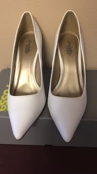 pair of gray leather pointed-toe heeled pumps