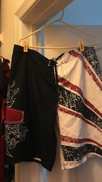 Black, white, and red board shorts