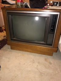 gray CRT television with brown wooden TV hutch Mechanicville, 12118