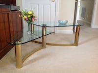 Glass and bronze table for a living room