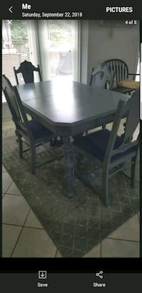 rectangular black wooden table with four chairs dining set Poolesville, 20837
