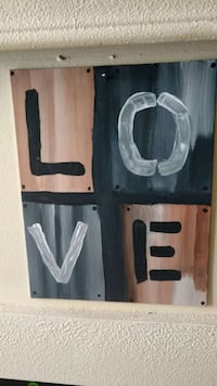 love black wooden wall signage