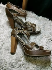 pair of brown leather open toe ankle strap heels Calgary, T2B 1G2