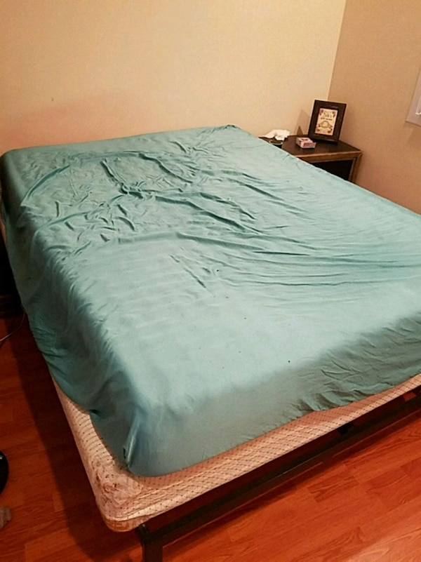 Purple mattress and bed frame