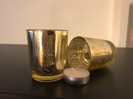 Two small candle holders and candles