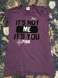 Pink t-shirt in good shape worn 2 times don't like how it fits and is real pink pick up only  Regina, S4T 4T1